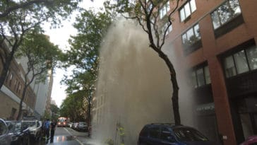 Firefighters work to turn off water to broken hydrant/SpotNews.tv for Upper East Site