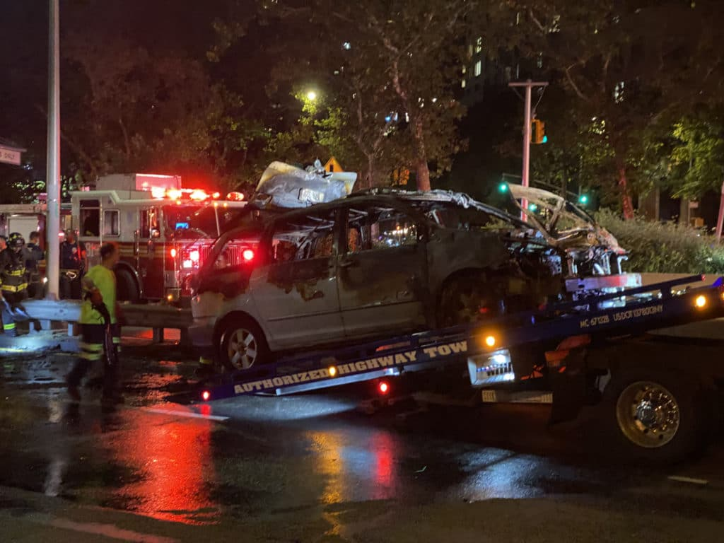 Burned out minivan loaded onto flatbed on the FDR Drive/Upper East Site